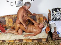 Old married couple and their sexual adventure in living room