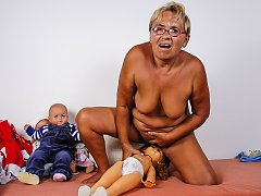 Fat old granny loves playing with doll