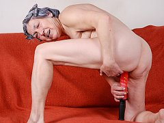 Gray-haired pussy and big red dildo