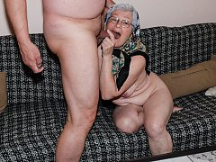 Old Grandma on the couch sucking cock