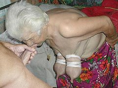 Lesbian granny with pretty girl playing with a toy